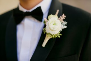 white-ranunculus-boutonniere-with-sprigs-of-pink-and-green
