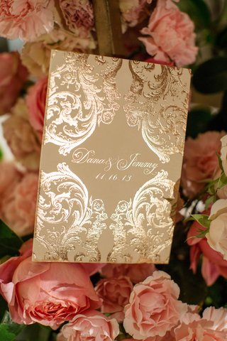 metallic-ceremony-booklet-and-pink-peonies