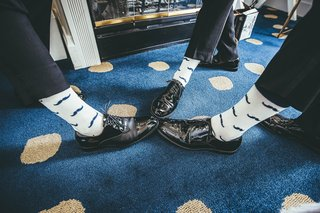 groom-and-groomsmen-show-off-socks-with-mustache-print
