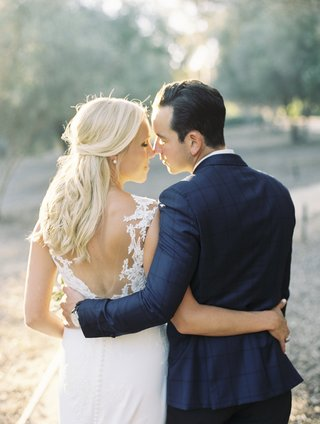 bride-in-pronovias-wedding-dress-groom-in-blue-windowpane-suit-jacket-bride-and-groom-from-back