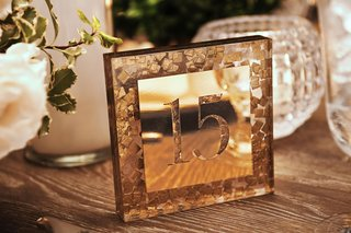 mosaic-confetti-table-number-gold-metallic-mirror-reflecting-candlelight