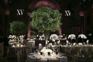 wedding-reception-at-cipriani-wall-street-with-red-uplighting-greenery-centerpiece-white-orchids
