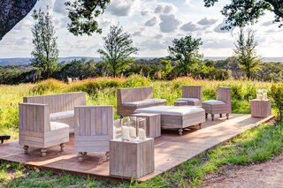 outdoor-wedding-lounge-area-with-furniture-composed-of-wooden-slats