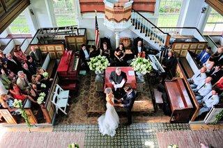 bride-in-a-berta-bridal-gown-exchanges-vow-with-groom-in-a-navy-ralph-lauren-tuxedo