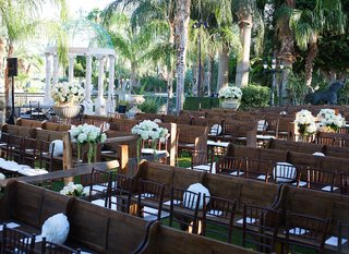 wooden-church-pews-and-mahogany-chairs-at-outdoor-wedding