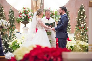 wintry-ceremony-christmas-details-bride-groom-north-carolina-wedding-trees-catholic-church-pews