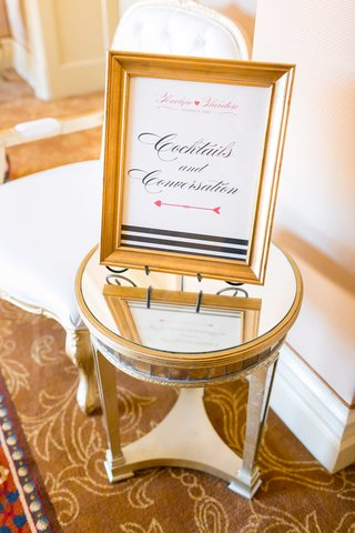 mirror-side-table-with-gold-frame-black-white-striped-design-cocktails-and-conversation-sign-party