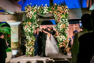 wedding-ceremony-arch-chuppah-white-rose-anemone-peach-pink-blush-orange-flowers-country-club-jewish