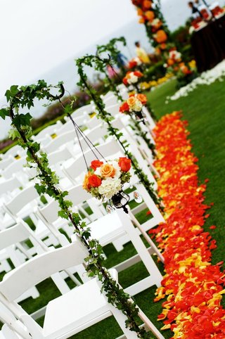 orange-and-yellow-petals-along-aisle