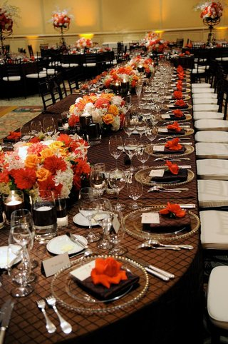 long-oval-table-with-bright-floral-centerpieces