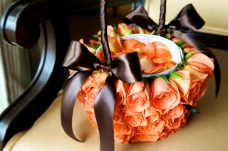 apricot-roses-covering-flower-girl-basket
