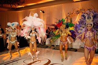 women-in-bikinis-and-large-headdresses-dancing