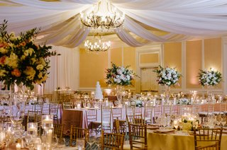 wedding-reception-in-ballroom-at-the-ballantyne-resort-in-charlotte-north-carolina-chandelier-drapes