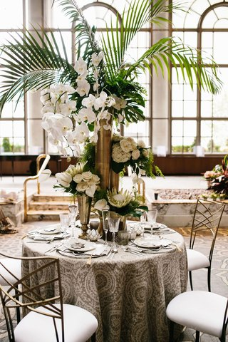 wedding-reception-styled-moroccan-wedding-shoot-pattern-linen-gold-chair-white-flower-palm-greenery