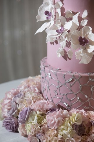 wedding-cake-with-white-sugar-flower-with-purple-center-fresh-flower-base-silver-web-design-sequins