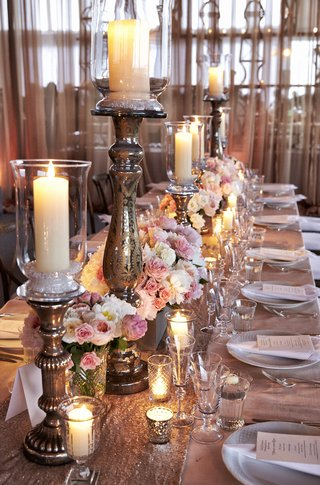 wedding-reception-table-with-sequin-runner-pink-and-white-flowers-and-candleholders