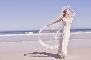 bhldn-wedding-dress-on-beach-with-lace-flower-applique-veil