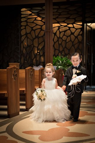 flower-girl-in-tulle-white-dress-with-basket-and-ring-bearer-in-black-tux-with-ring-pillow
