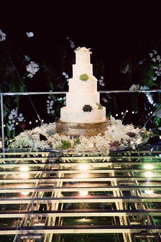 5-tier-wedding-cake-with-succulent-accents-on-floating-display