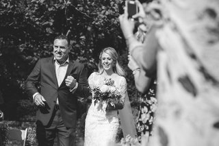 black-and-white-photo-of-emotional-walk-down-aisle