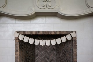 wedding-banner-with-couples-names-on-fireplace-mantle