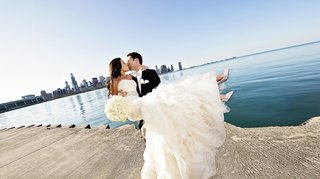 bride-in-vera-wang-wedding-dress-kisses-groom-at-chicago-lakefront-trail