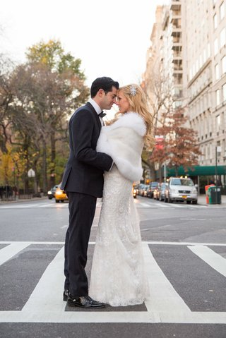 a-bride-and-groom-embrace-one-another-in-the-crosswalk-of-a-street-in-new-york-city