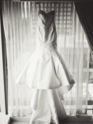 black-and-white-photo-of-trumpet-wedding-dress-with-large-open-skirt-and-long-train