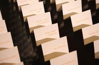 orange-block-type-on-white-escort-cards-lori-wolf-and-carol-leifer-wedding-jane-lynch-bill-maher