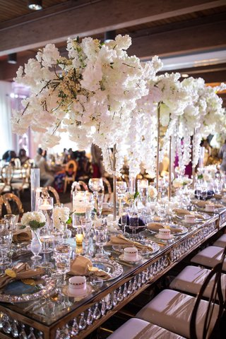 wedding-reception-long-table-with-crystals-in-between-top-and-bottom-crystal-charger-mirror-top