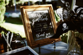 wedding-guest-book-sign-chalkboard-gold-frame-strike-a-pose-snap-a-photo-stick-it-in-the-book