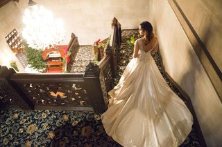bride-long-ball-gown-descending-stairs-ersa-atelier-wedding-styled-shoot-vintage-train-estate