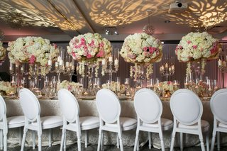 patterned-uplighting-ivory-and-blush-centerpieces-white-round-backed-chairs