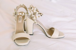 valentino-wedding-shoes-white-ivory-sandal-with-thick-heel-and-gold-pyramid-studs-on-straps