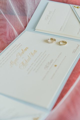 invitation-suite-trifold-booklet-in-pale-blue-embossed-invitations-gold-wedding-rings
