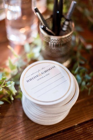 wedding-reception-idea-cocktail-hour-guest-book-alternative-coasters-with-lines-to-write-advice