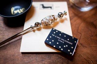 hector-maldonado-train-wedding-matchbook-black-with-gold-polka-dots-and-wedding-date