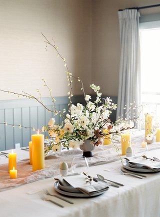 goldenrod-pillar-candles-for-bridal-shower-table-soft-color-palette-unique-floral-arrangements