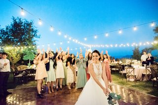 outdoor-wedding-reception-patio-string-lights-bistro-bride-bouquet-toss-megan-nicole-youtube-singer