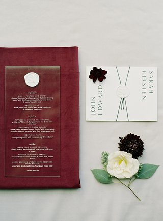 wedding-paper-goods-eescort-cards-envelope-and-acrylic-menu-with-white-wax-seal-burgundy-napkin