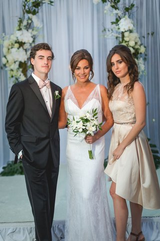 luann-de-lesseps-with-son-noel-and-daughter-victoria-in-high-low-dress-flower-girl-ring-bearer