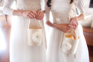 flower-girls-holding-unique-basket-filled-with-peach-petals