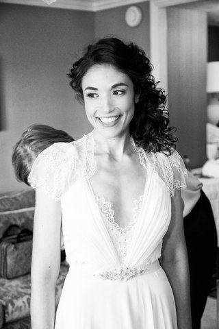 black-and-white-photo-of-bride-in-a-jenny-packham-dress-with-lace-sleeves-details-at-neckline