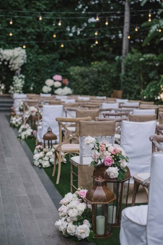 beverly-hills-four-seasons-wedding-ceremony-outdoor-rustic-chairs-lanterns-white-pink-roses