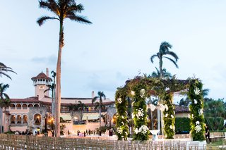 wedding-ceremony-at-mar-a-lago-club-gold-chairs-seated-in-the-round-for-clear-view-of-ceremony