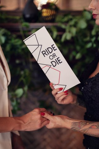 wedding-ceremony-with-bride-reading-vows-from-a-card-with-ride-or-die-on-the-cover
