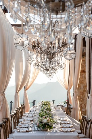 wedding-reception-at-malibu-rocky-oaks-vineyard-estate-long-kings-table-with-flower-runner-drapery