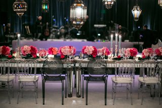 ghost-chairs-with-monogram-at-head-table-with-pink-low-centerpieces