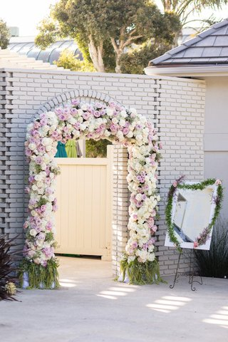 floral-archway-entrance-to-wedding-reception-blush-and-ivory-roses