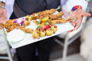 wedding-cocktail-hour-with-passed-skewered-appetizers-and-small-bites-on-rectangular-tray